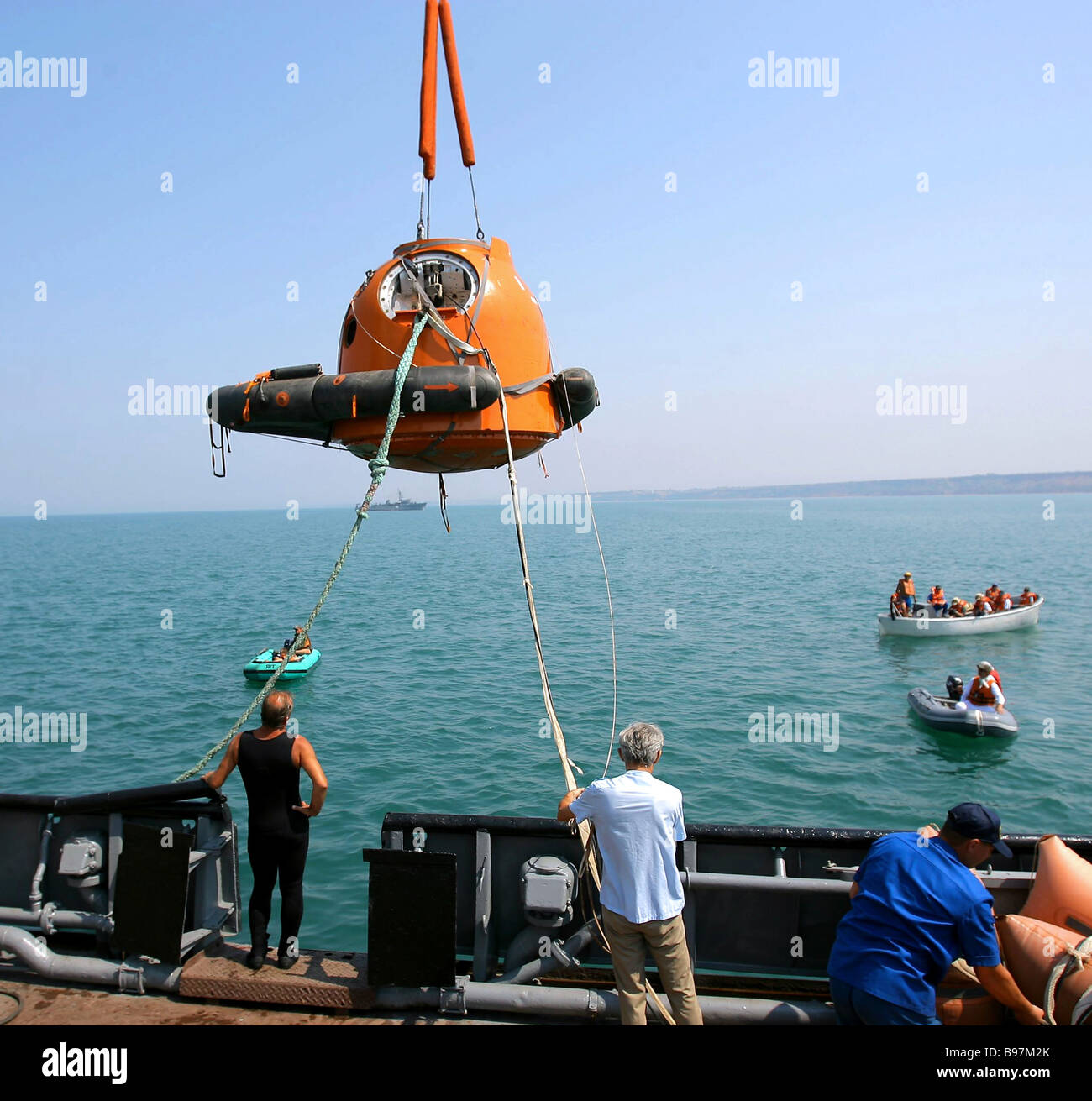 The Soyuz descent vehicle is lowered into water as international space crews are drilling emergency splashdown in - Stock Image
