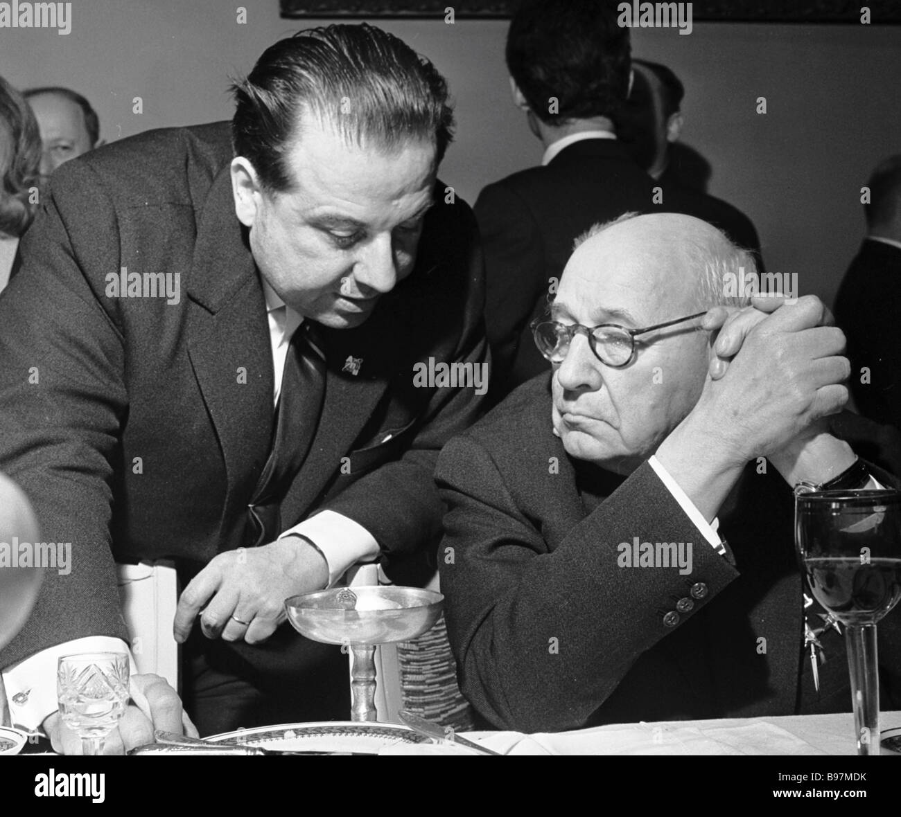 French journalist Kibiak Roger left talks to aircraft designer Andrei Tupolev right - Stock Image