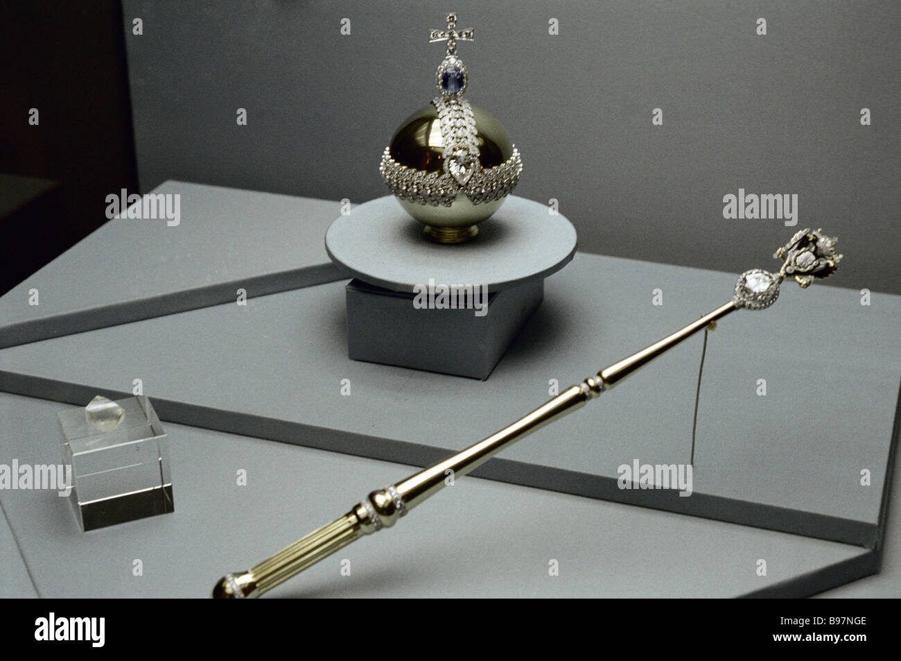 Reduced copies of the orb and the scepter at the Russia s Gold Treasury exhibition - Stock Image