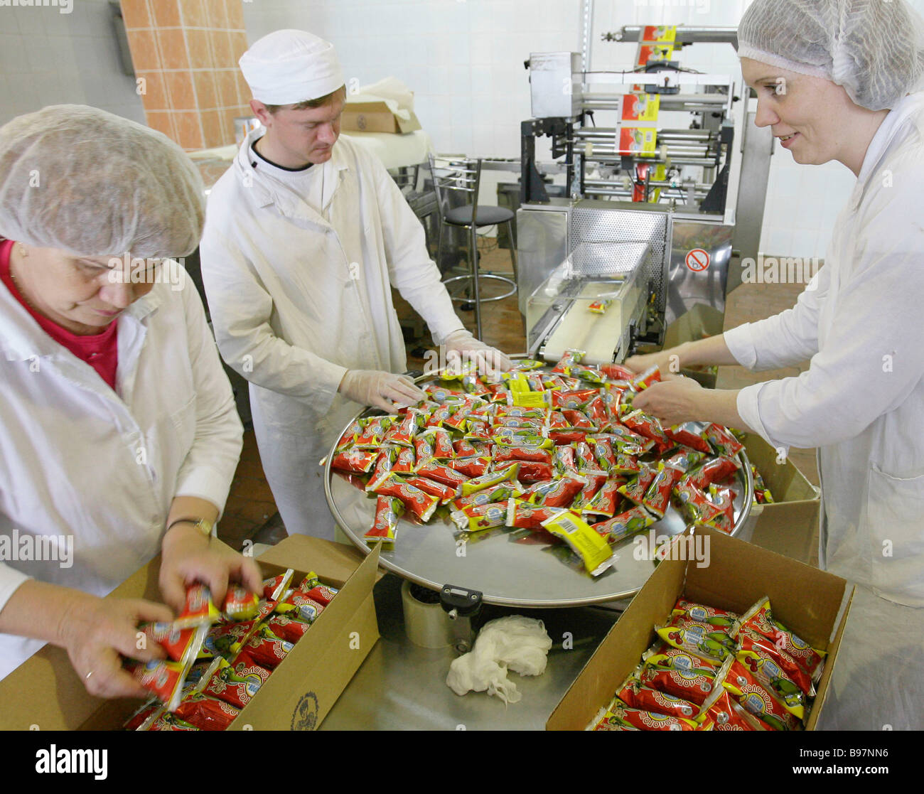 Chocolate glazed cottage cheese packaging line at the Vologda Dairy Factory - Stock Image