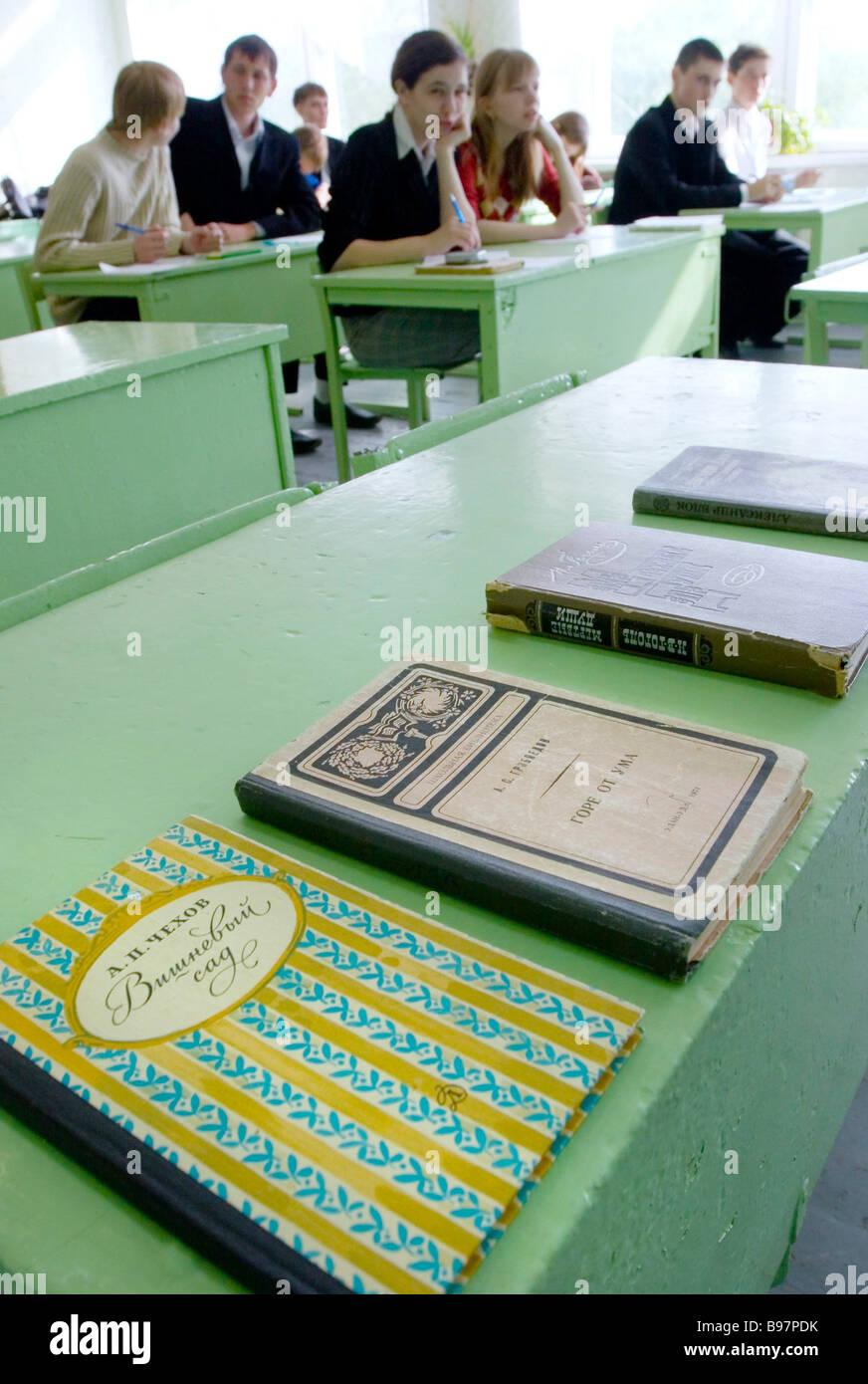 Senior students taking written exam in literature at one of Kurgan secondary schools - Stock Image