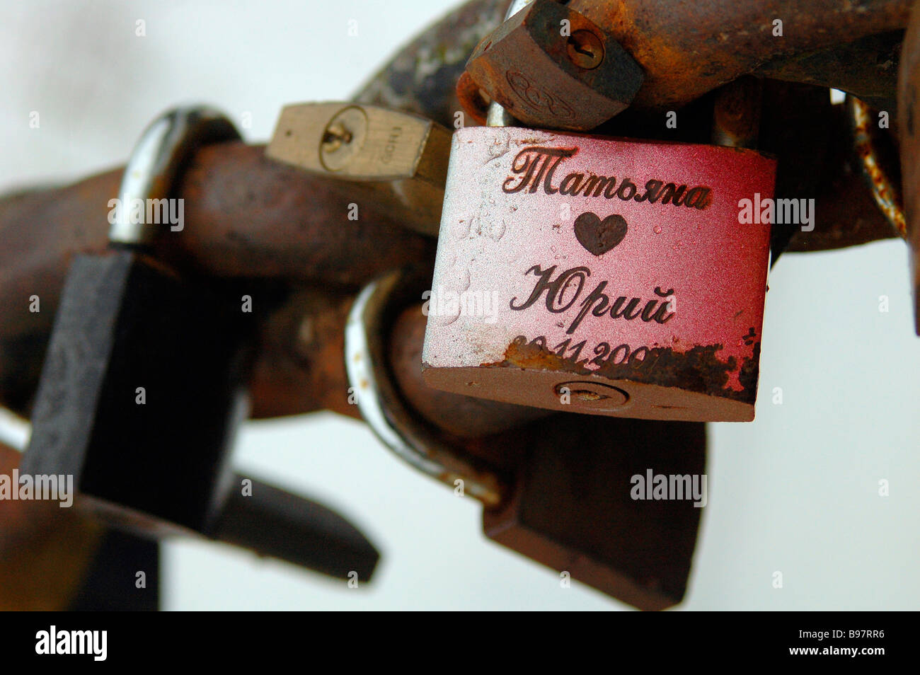 Padlocks love forever rust Cyrillic chain promise lock chain together commitment marriage symbolic key keylock keychain, - Stock Image