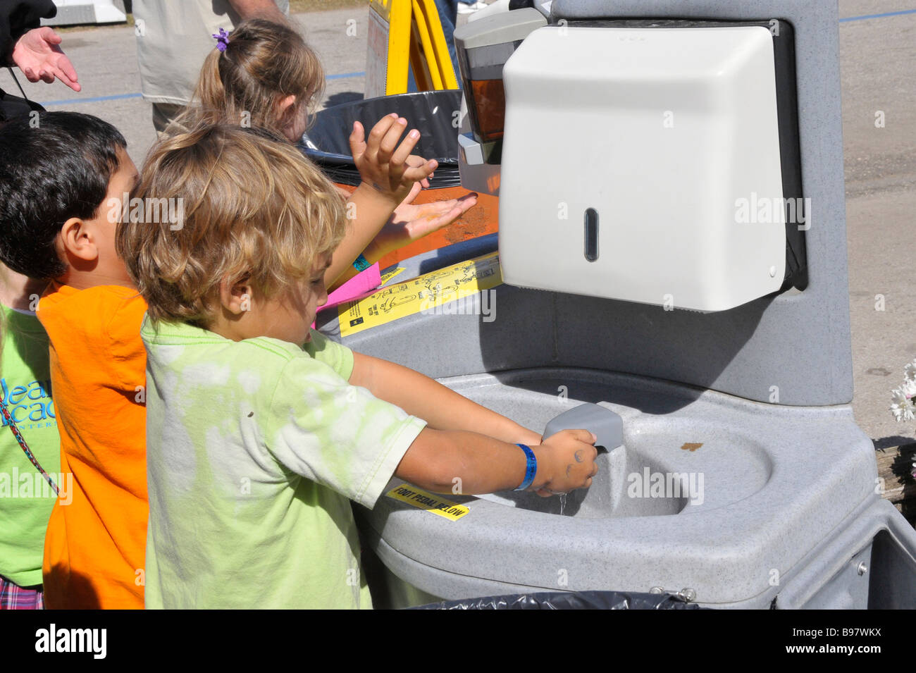 Children Wash Hands at Hand Wash Station at Florida State Fairgrounds Tampa - Stock Image