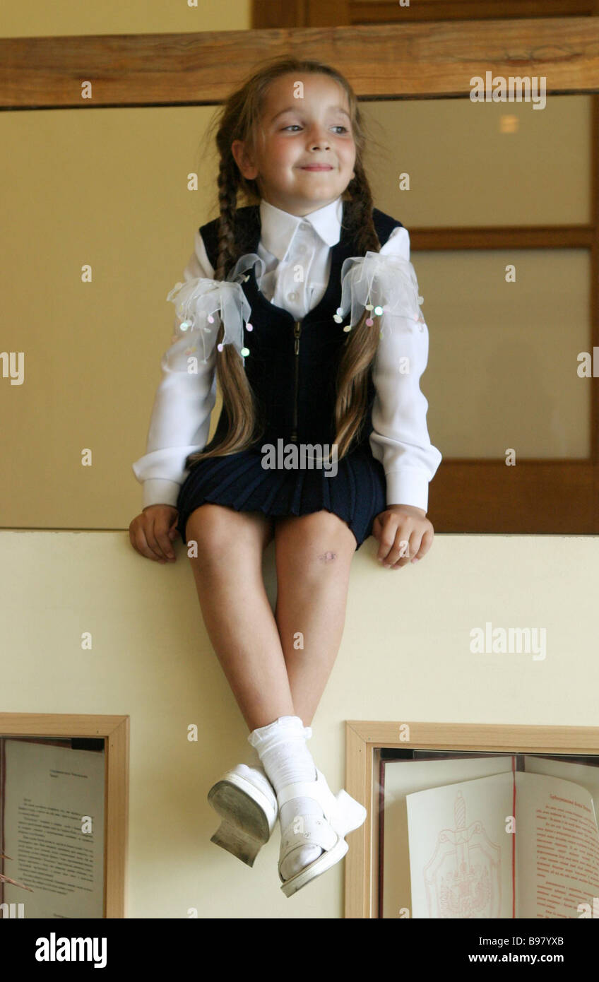 A Little Girl Demonstrates This Pretty Dress During A Roundtable On