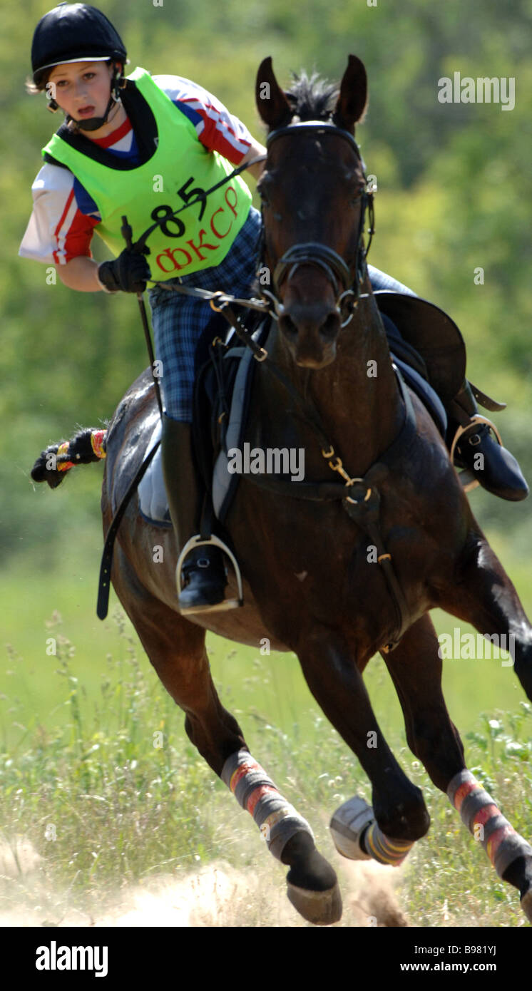 Oksana Chonka Russia on Jorge during the Eventing World Cup at the Planernaya sports center in the Moscow Region - Stock Image