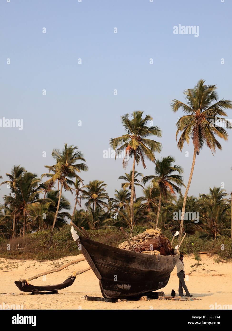 India Goa Colva beach fishing boat palms - Stock Image