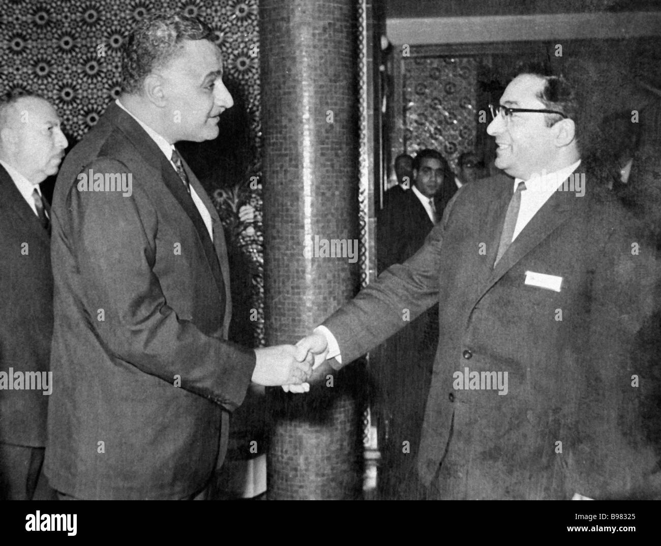 Egyptian President Gamal Abdel Nasser left greets Doctor of Philology and Arabic language professor Grigory Sharbatov - Stock Image