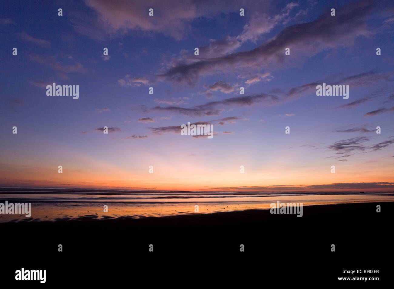 Dramatic sky over the ocean just after sunset in Dominical, Costa Rica. - Stock Image
