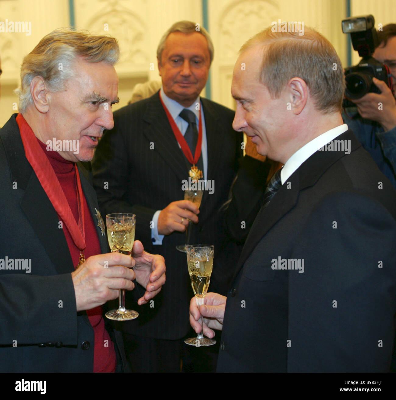 Right to left Russia s President Vladimir Putin Vitali Ignatenko ITAR TASS Director General and Viktor Korshunov - Stock Image