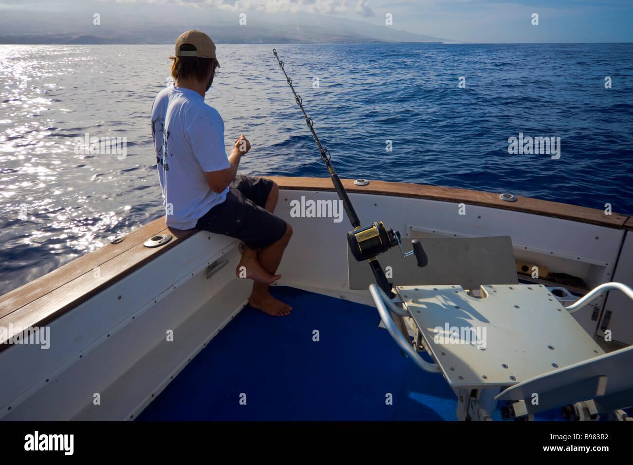 Big game fishing preparing bonito lure on fishing boat Saint Gilles La Réunion France   Hochseeangler präpariert Stock Photo