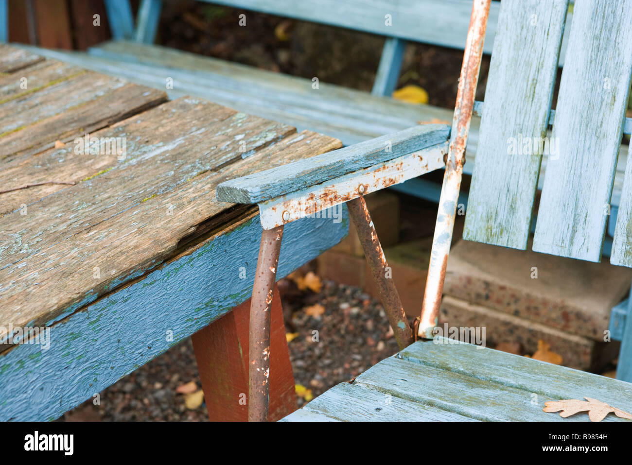 Dilapidated chair and table, close-up - Stock Image