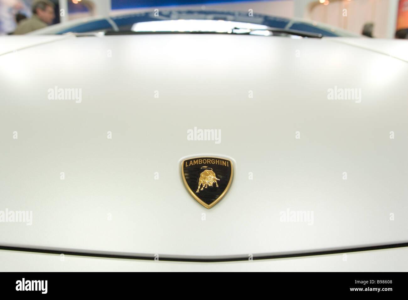Emblem on the bonnet of a Lamborghini sports car - Stock Image