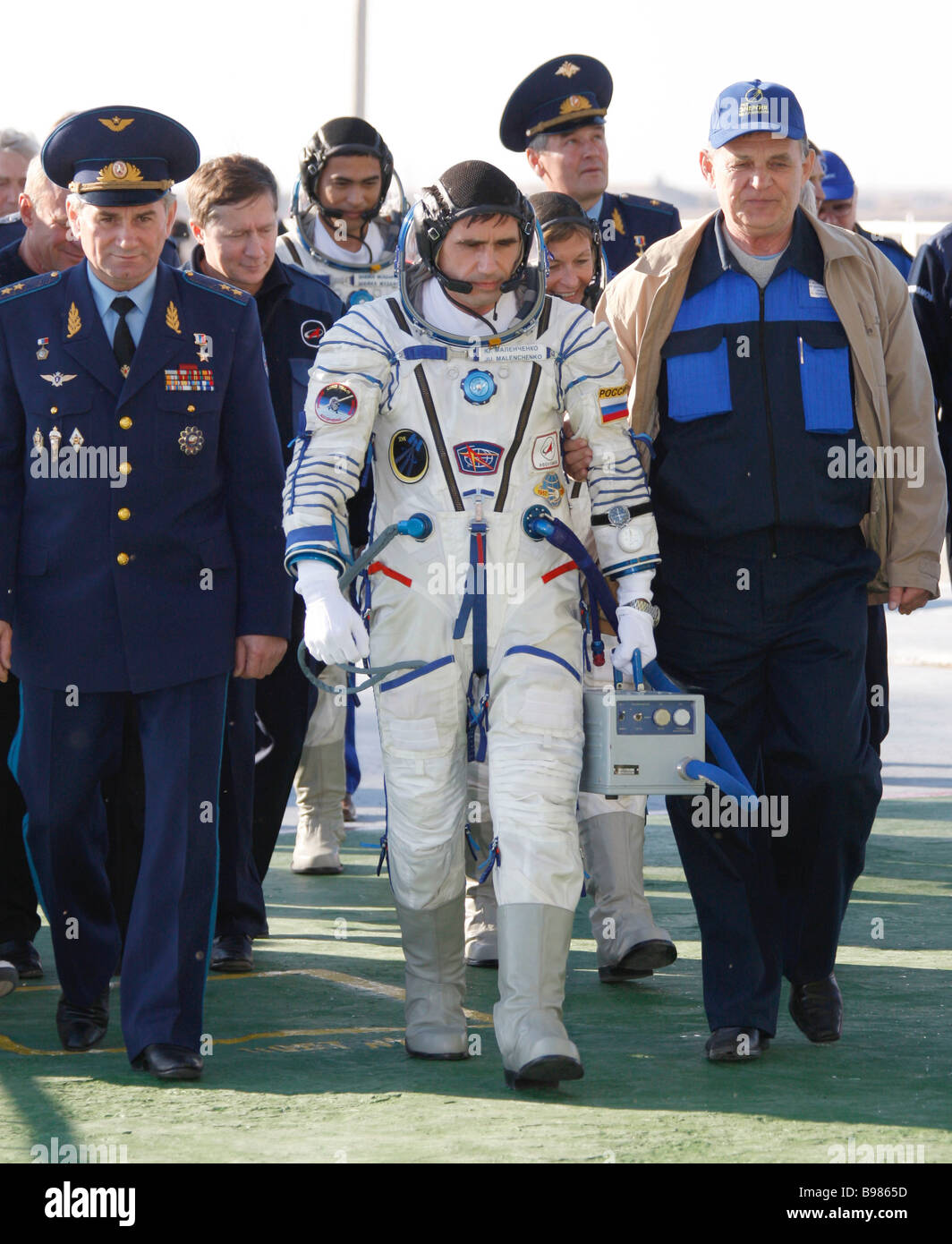 Russian cosmonaut Yury Malenchenko in the center of the 16th ISS expedition crew in Baikonur - Stock Image