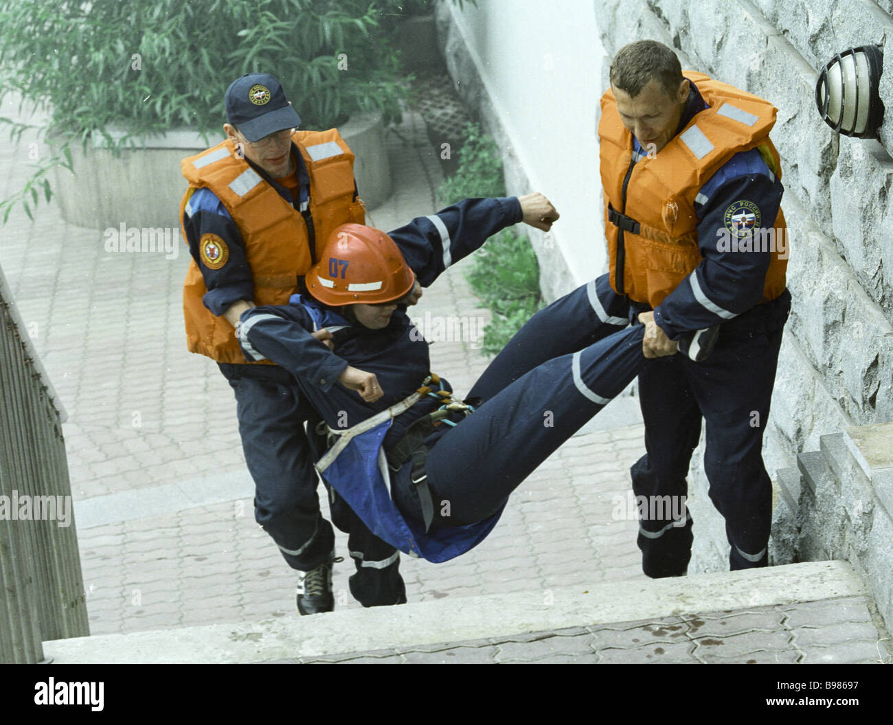 Rescuers removing a victim during a command and staff exercise on eliminating effects of terrorist acts - Stock Image