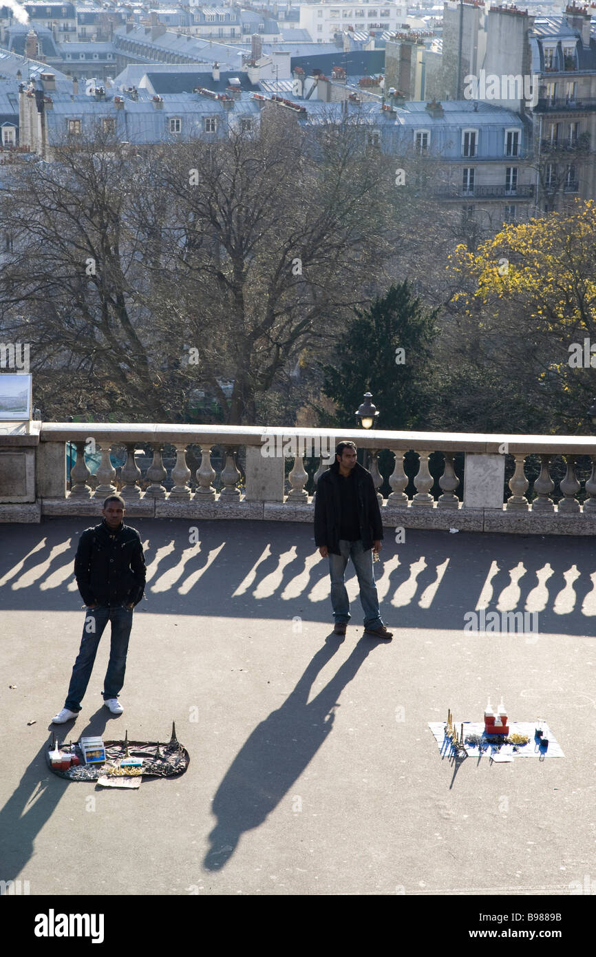 Street sellers look for customers, as they sell their gimmicky goods at Sacré-Cœur in Paris. Stock Photo