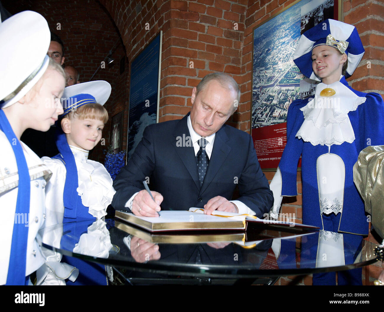 Russian President Vladimir Putin signing the book of guests of honor at the Kremlin gate museum - Stock Image