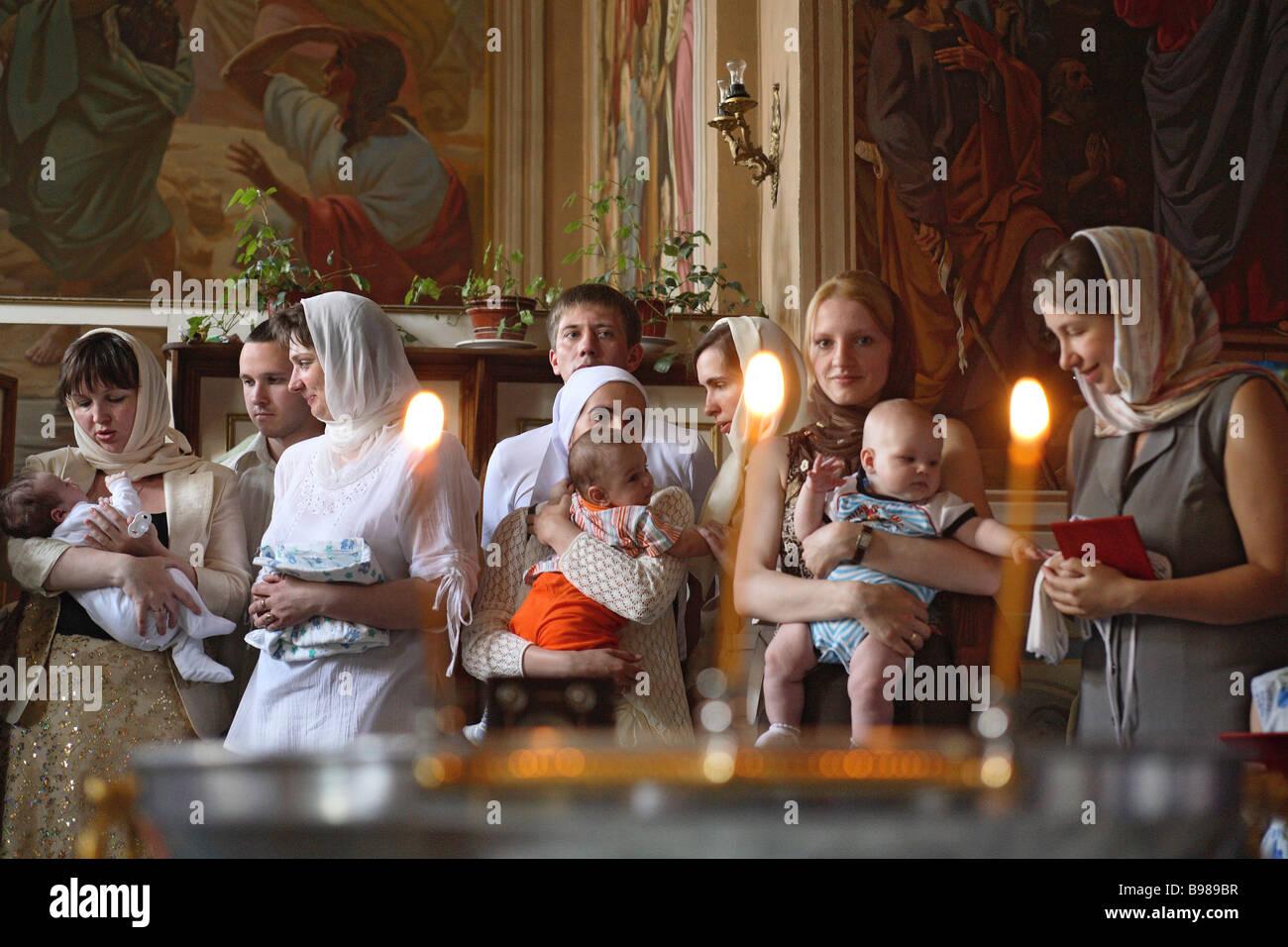 Baptizing infants in the St Daniil Monastery - Stock Image