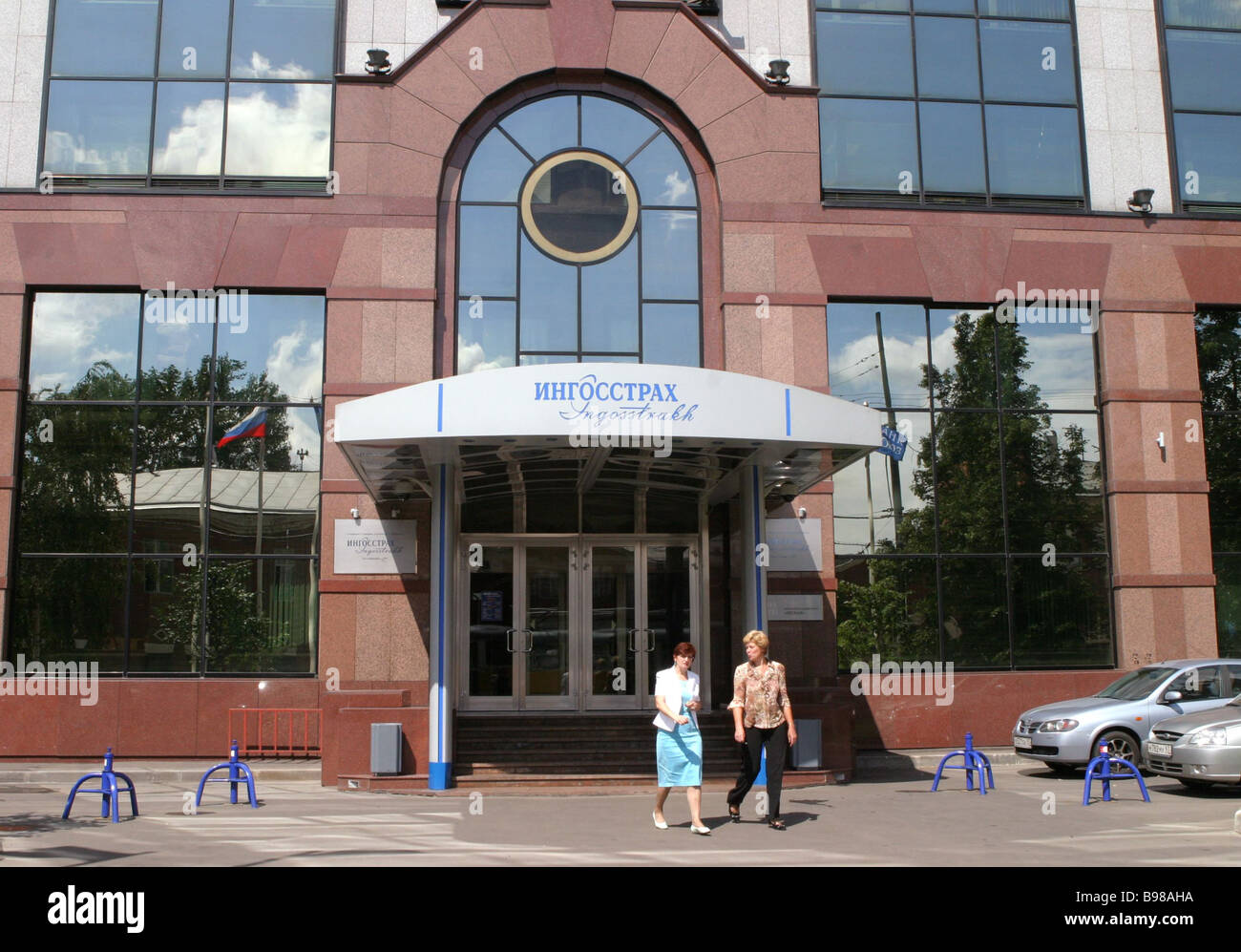 Moscow Edifice of the Ingosstrakh open end joint stock company in Lesnaya Street Main entrance - Stock Image