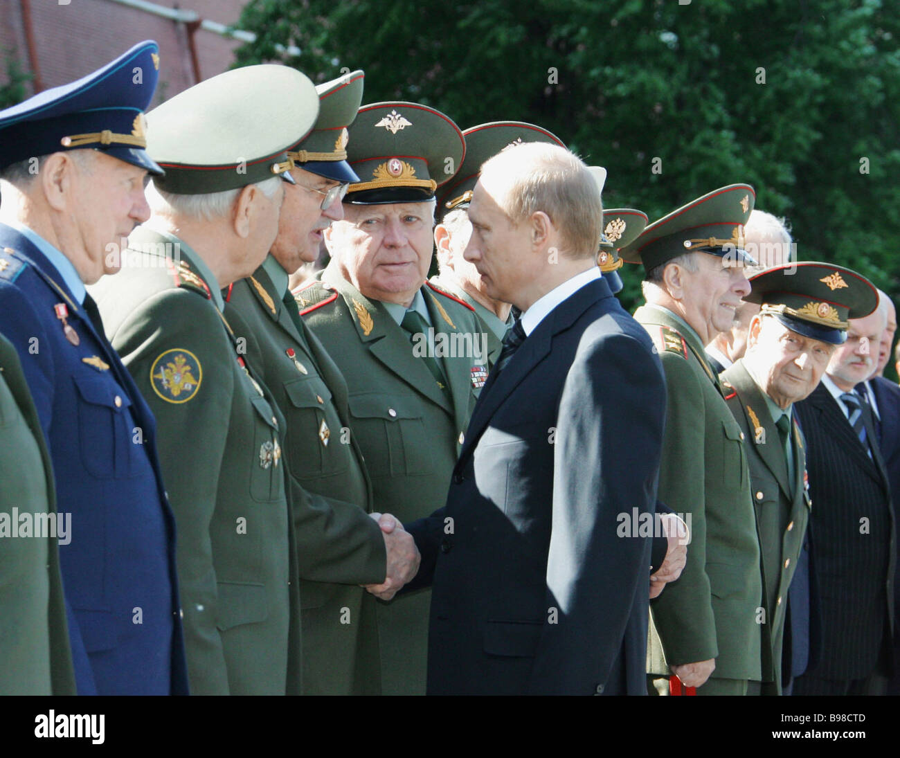 Russian President Vladimir Putin right met with veterans during the wreath laying ceremony at the Tomb of the Unknown - Stock Image