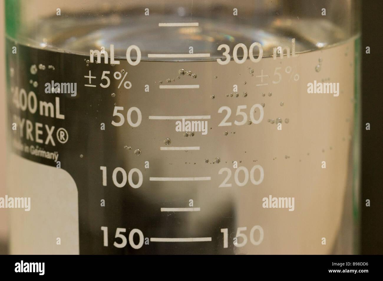 Laboratory beaker with clear liquid - Stock Image