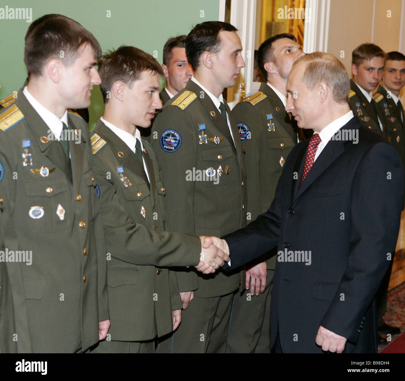 Russian President Vladimir Putin right congratulated graduates of military academies and universities in the Grand - Stock Image