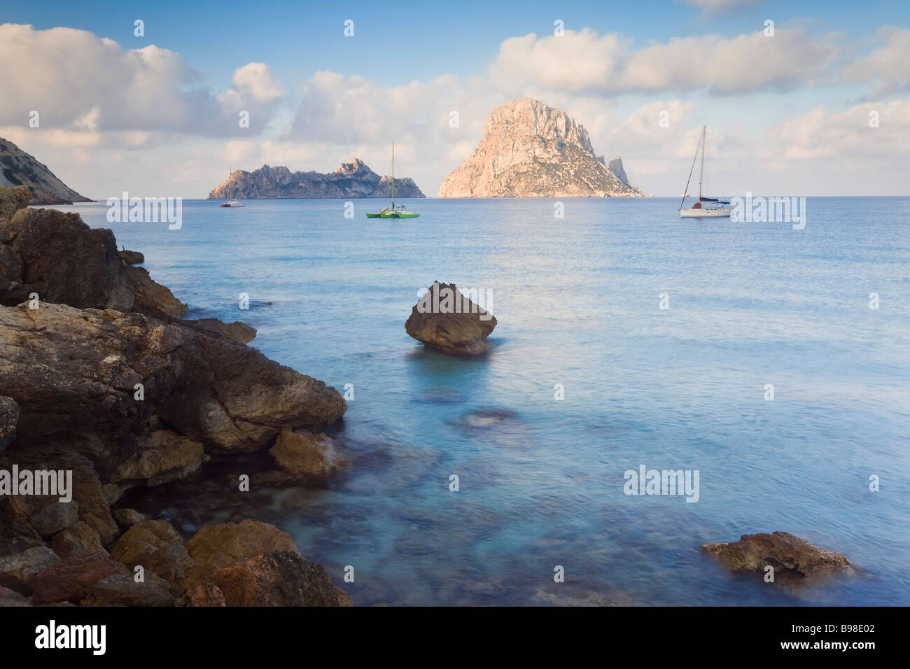 View of the rocky islet of Es Vedra from Cala d Hort near Sant Antoni Ibiza Balearic Islands Spain Mediterranean - Stock Image