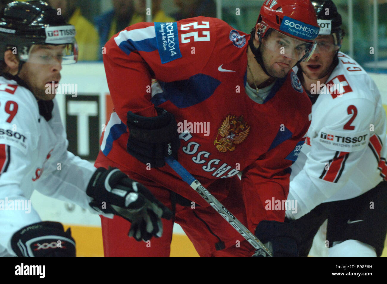 Swiss players Beat Forster left and Beat Gerber right and Alexander Radulov of Russia during the ice hockey world - Stock Image