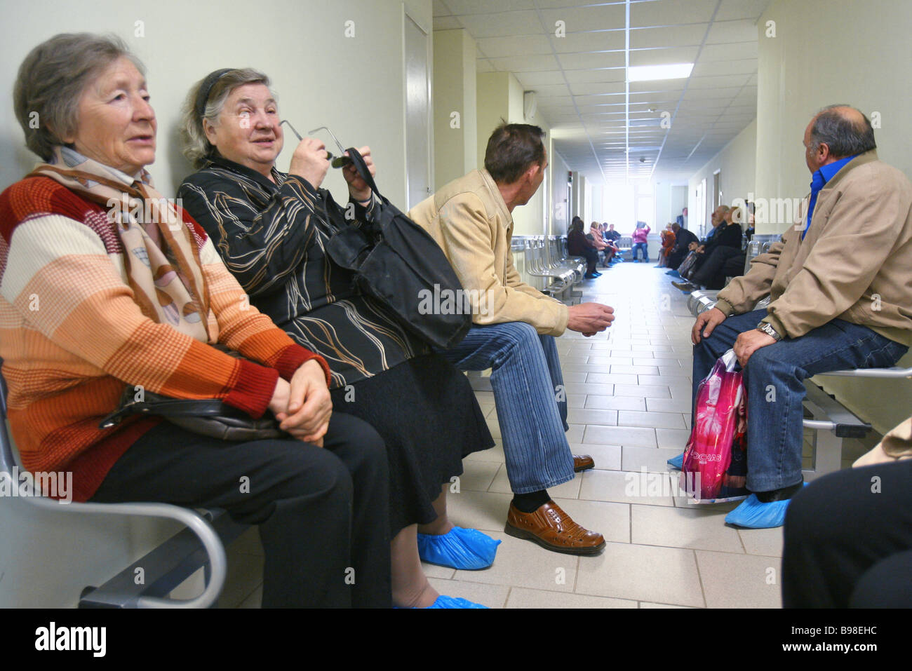 Outpatients waiting for reception at the Professor Rozanov District Hospital a municipal disease prevention center - Stock Image