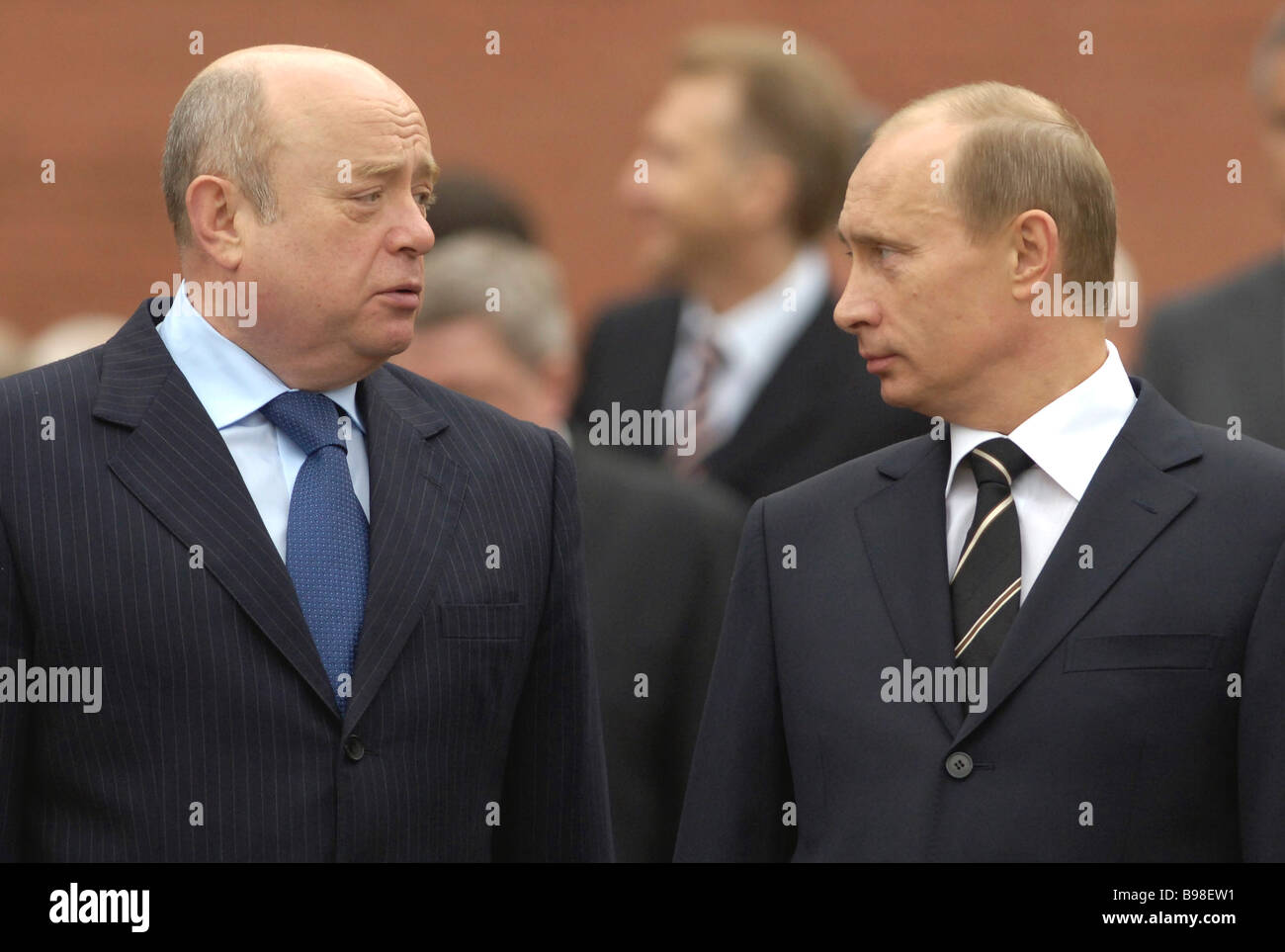 Russian President Vladimir Putin and Prime Minister Mikhail Fradkov right to left watch guard of honor march byStock Photo