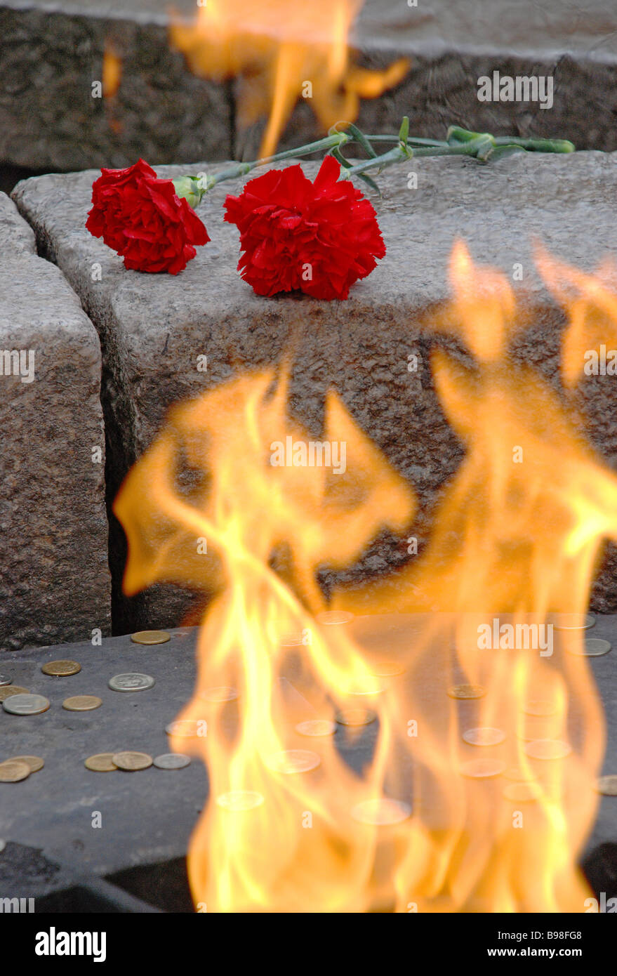 V E Day flowers at the Eternal Flame - Stock Image