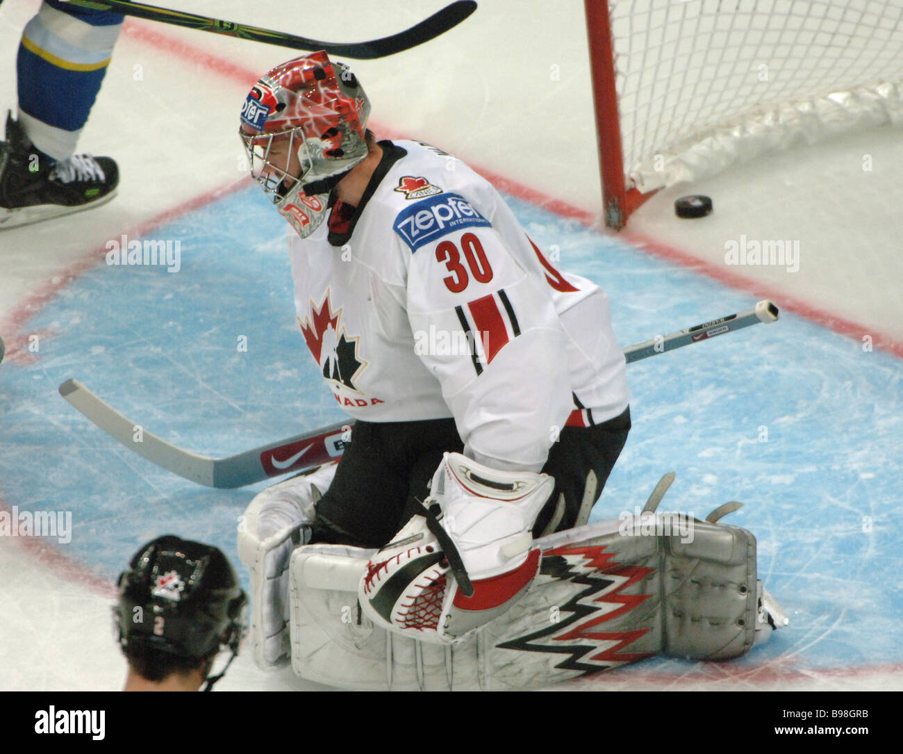 The puck in Canadian goalkeeper Cam Ward s goal during a semifinal match between Canada and Sweden of the World - Stock Image