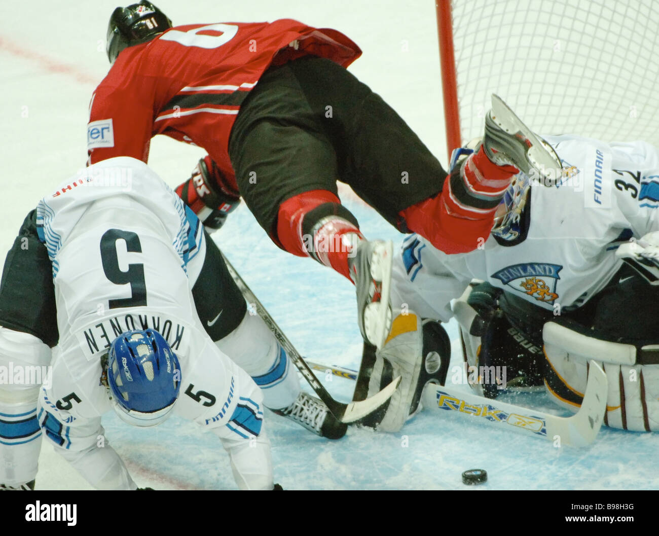 Canada s Shea Weber center fighting for the puck near the goal of Finland s Kari Lehtonen right during the ice hockey Stock Photo