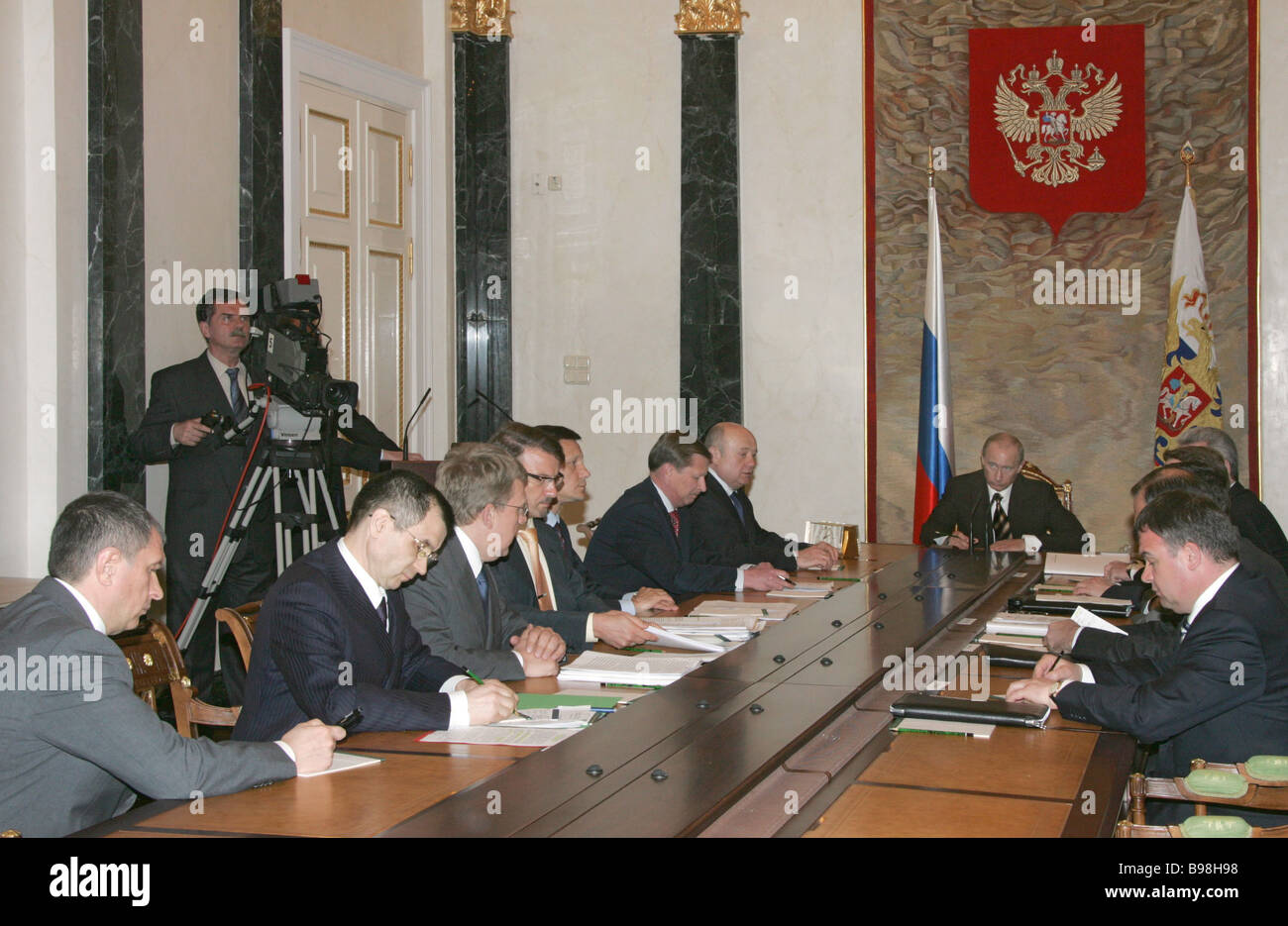 Russian President Vladimir Putin center during a Cabinet meeting in the Kremlin - Stock Image