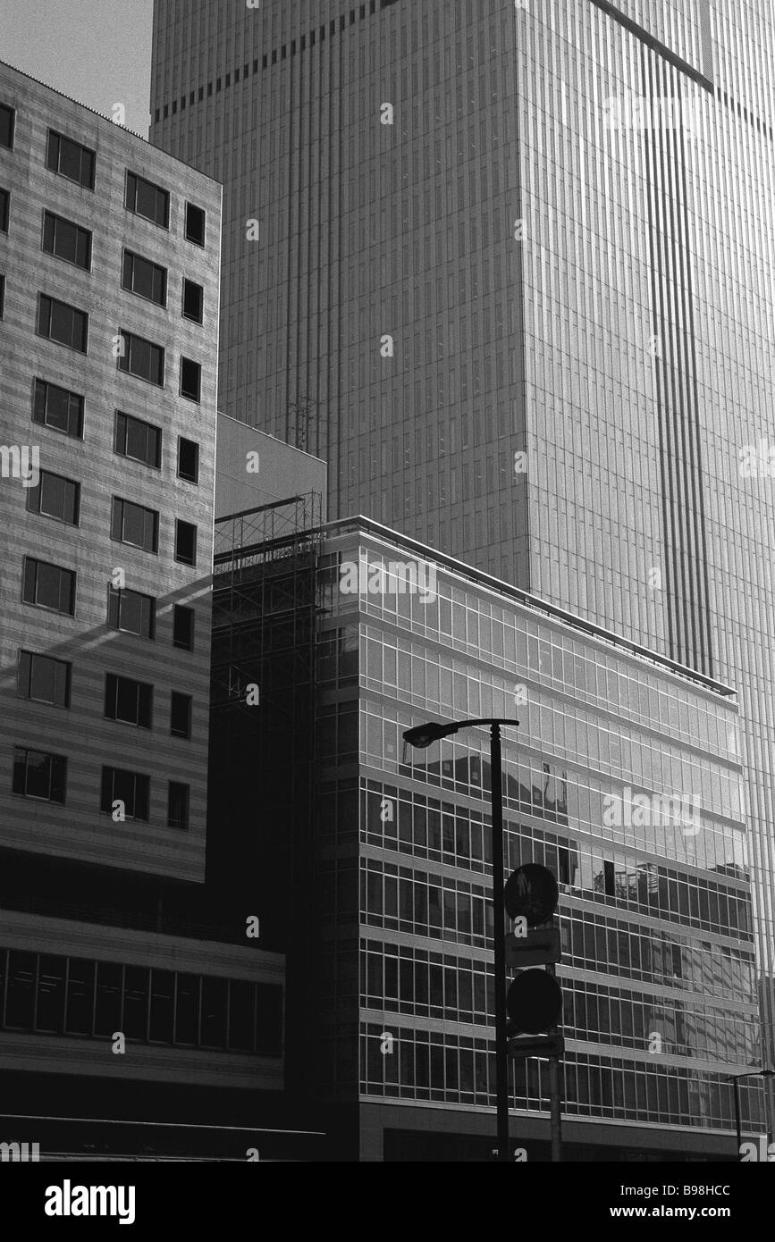 Office buildings rising side by side - Stock Image