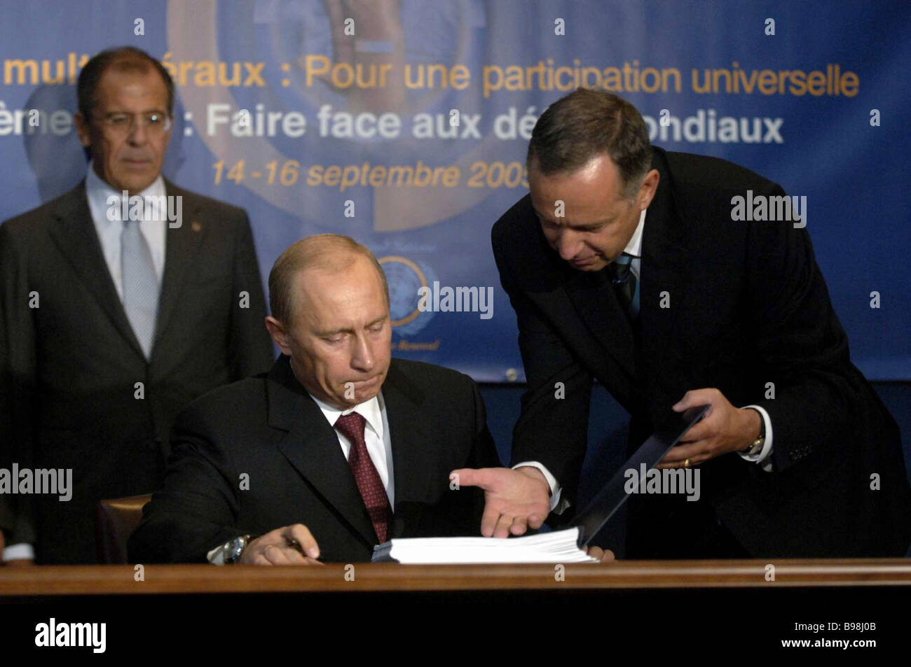 President of the Russian Federation Vladimir Putin centre signing an International Convention for the Suppression - Stock Image