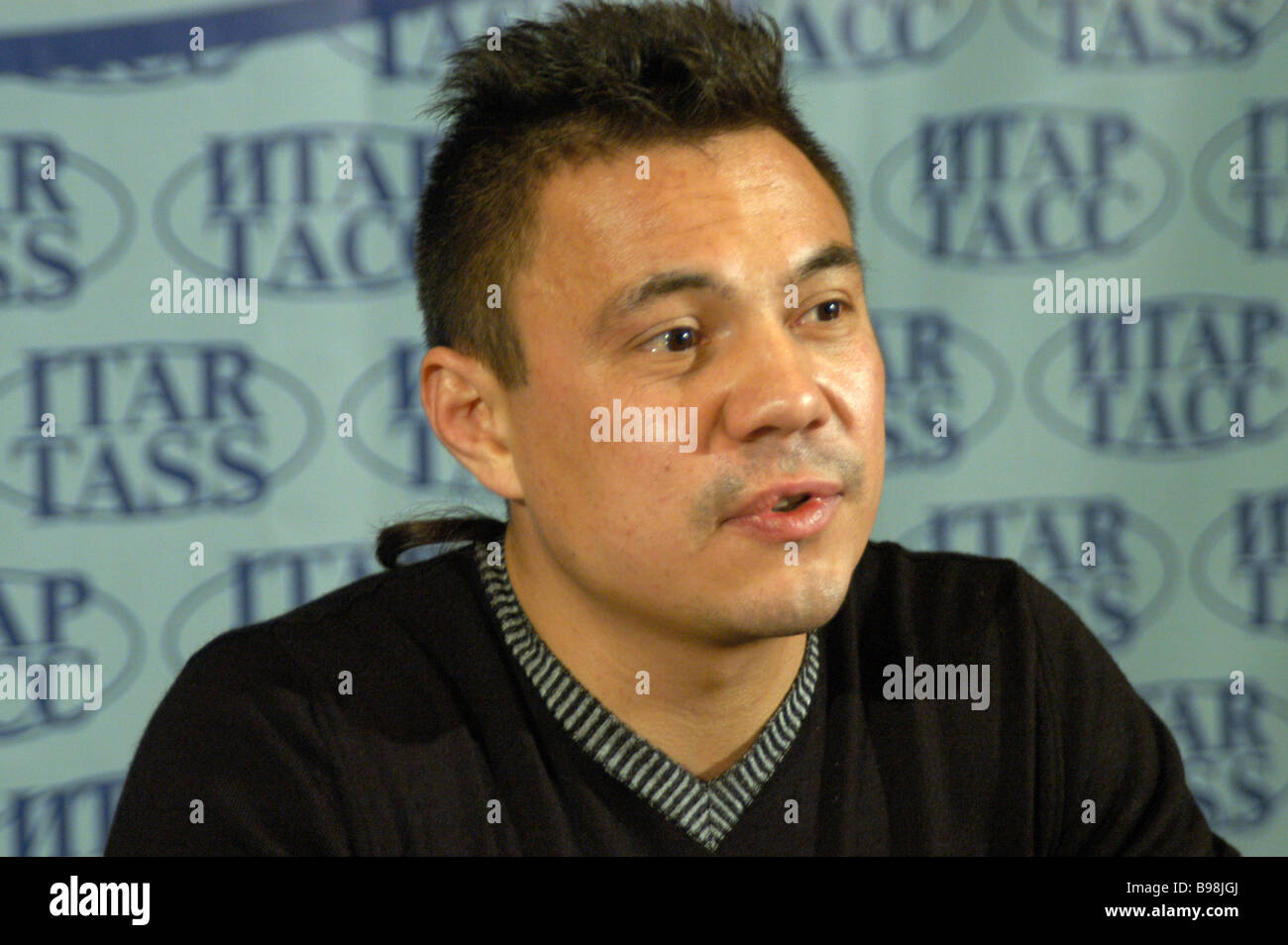 Super lightweight boxing world champion Konstantin Tzyu giving a press conference in ITAR TASS - Stock Image