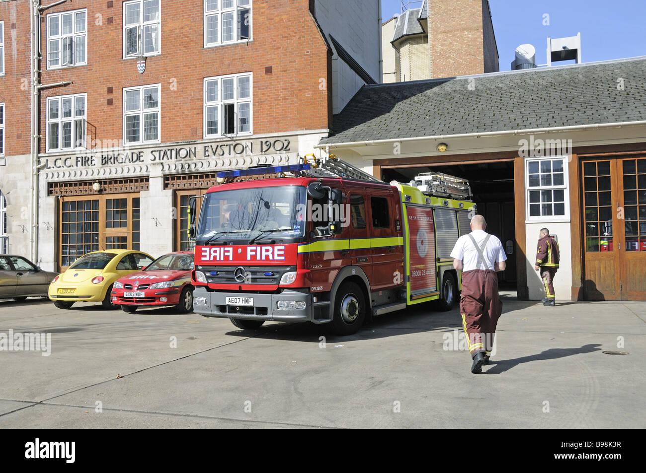 Fire Engine reversing into garage Euston Fire Station London England UK - Stock Image