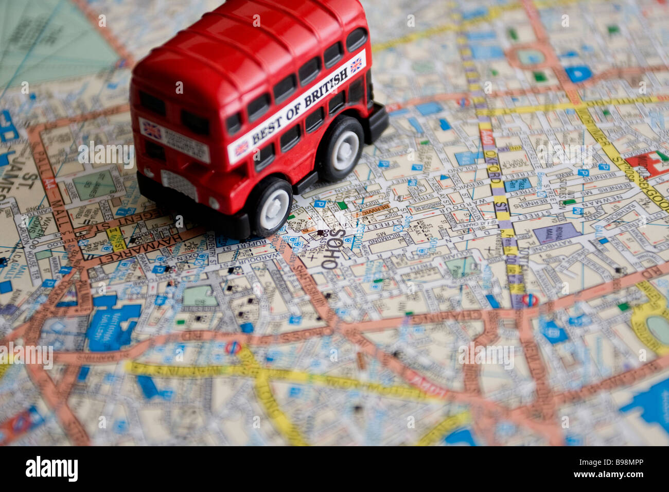 red double decker toy bus on london central map