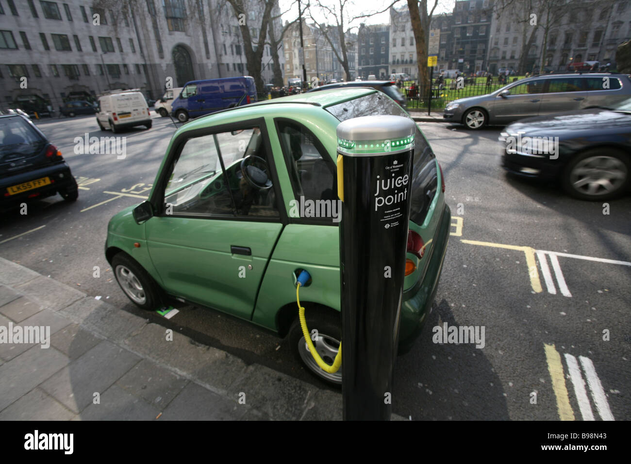 Electric vehicle being charged, Westminster, London - Stock Image