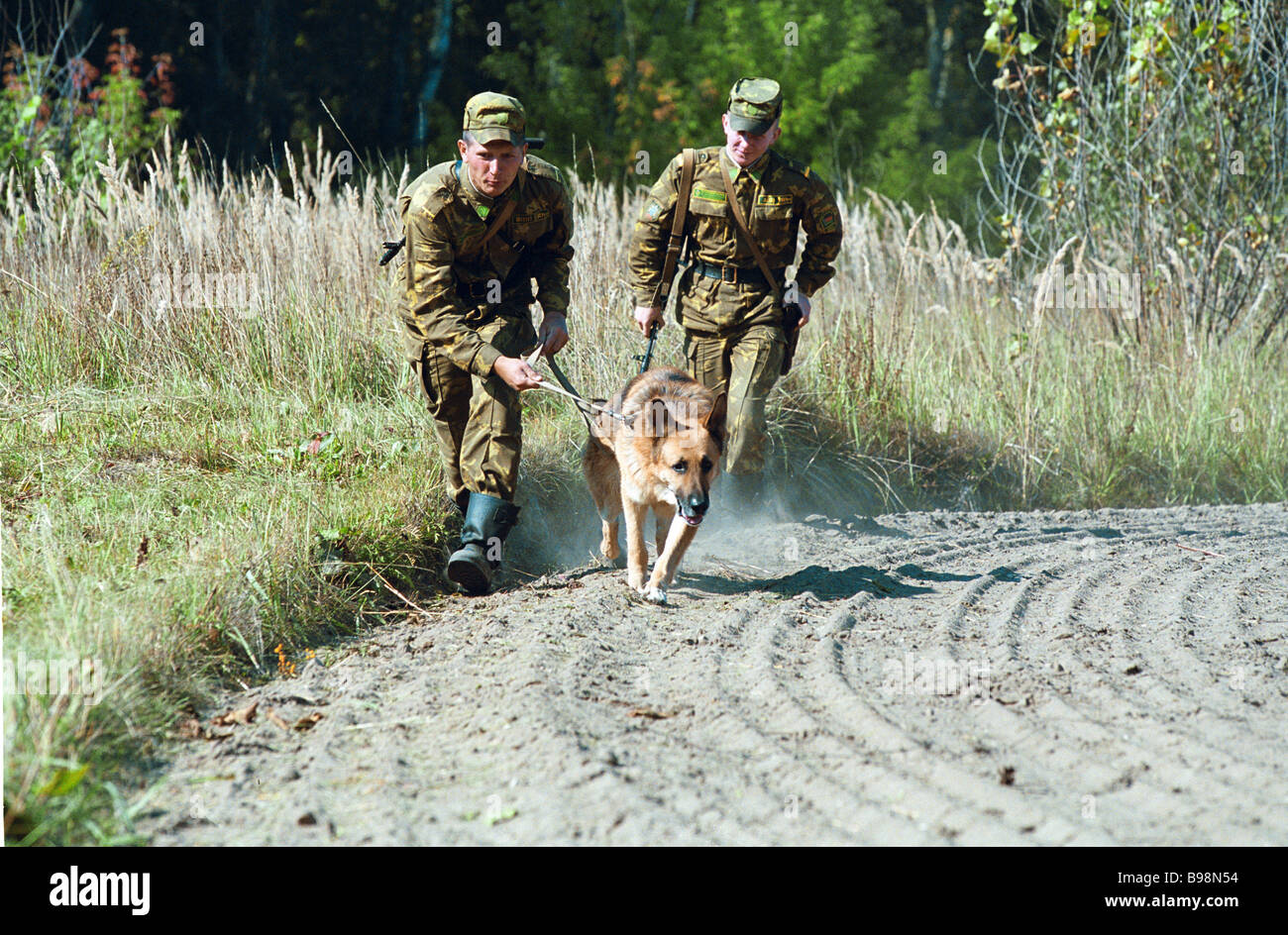 In pursuit of a trespasser leaving traces on the raked border strip Brest Belarus - Stock Image