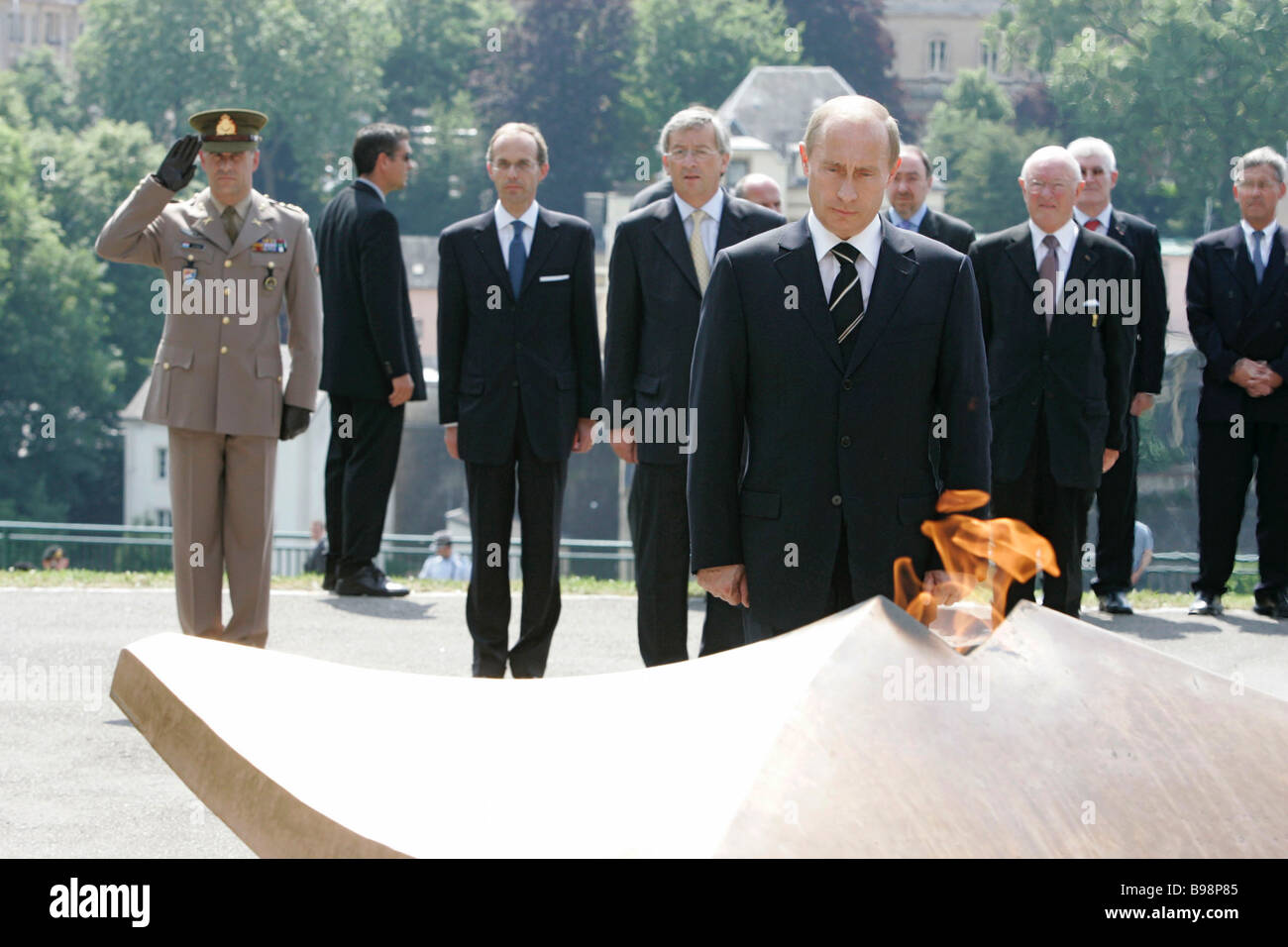 President Vladimir Putin foreground laid a wreath to the Eternal Fire in Luxembourg - Stock Image