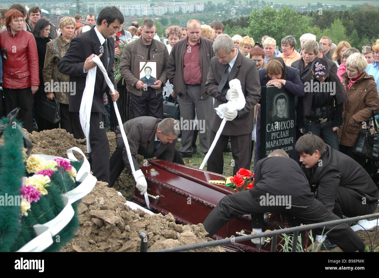 Funeral for miners killed in a methane explosion in the Yubileynaya mine took place at the Baydayevskoye Cemetery - Stock Image