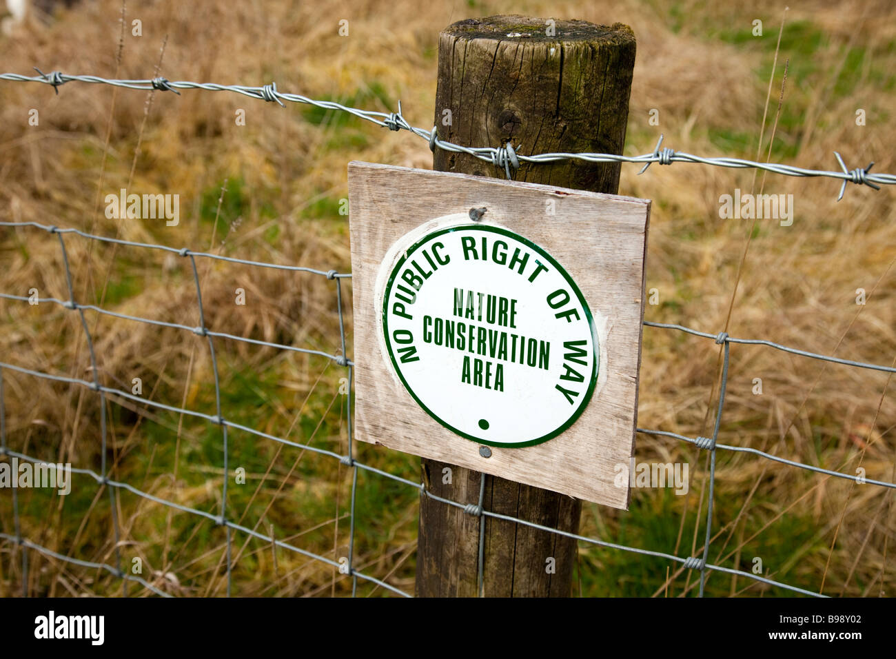 No Public Right of Way, Nature conservation area sign nailed to fence post - Stock Image