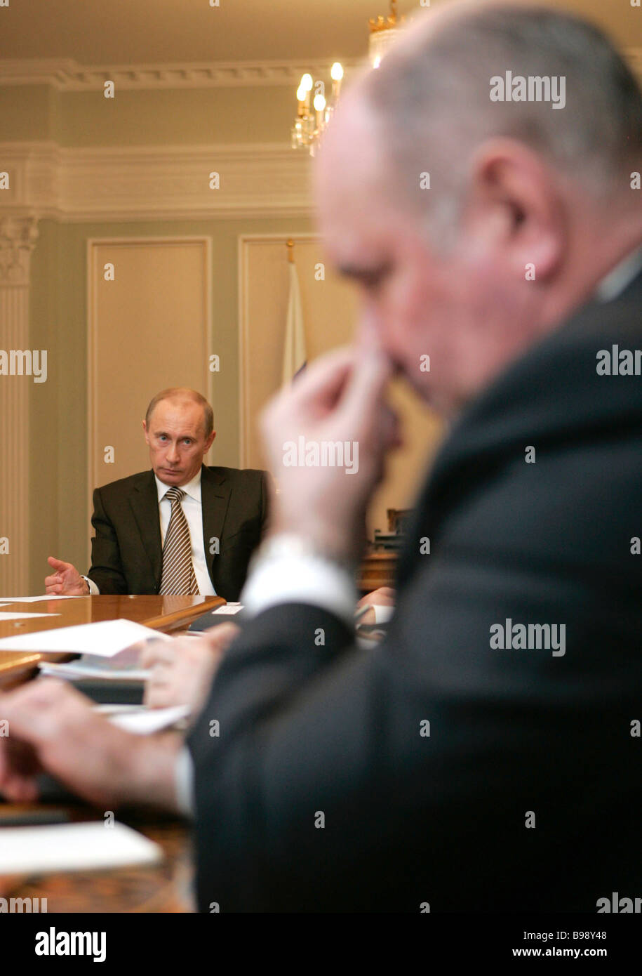 Russian President Vladimir Putin left and Deputy Foreign Minister Grigory Karasin during a meeting on the development - Stock Image