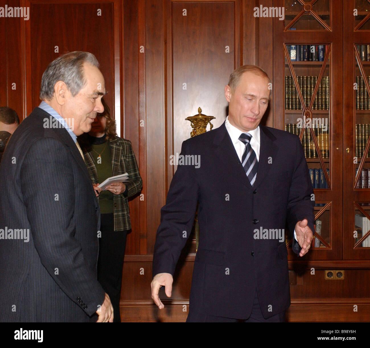 President Vladimir Putin of the Russian Federation and President Mintimer Shaimiyev of Tatarstan right to left meet Stock Photo