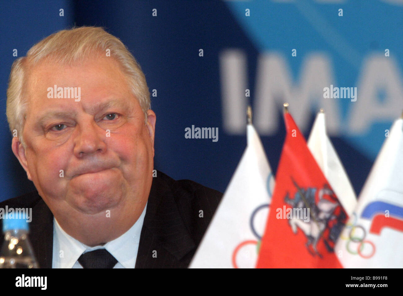 Vitaly Smirnov First Vice President of the International Olympic Committee speaking at press conference devoted - Stock Image