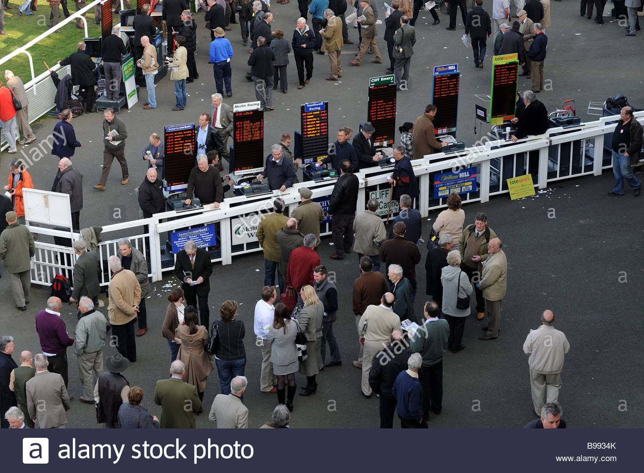 Punters place bets at Ludlow Racecourse Shropshire uk - Stock Image
