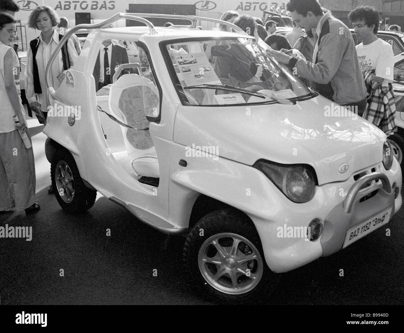 Visitors to 1995 international Moscow car show admire Lada Elf car - Stock Image