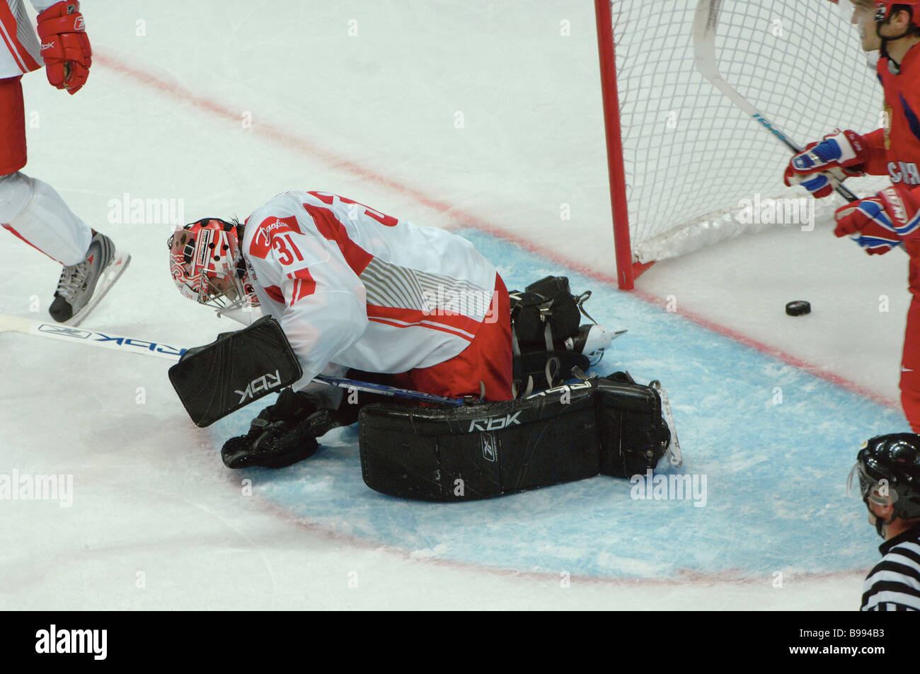 Danish goal keeper Peter Hirsch misses puck from Russian select team during the world ice hockey championship The - Stock Image