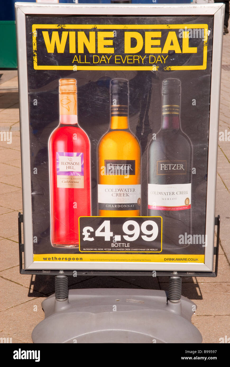 A sign offering cheap wine deals outside Weatherspoons pub bar - Stock Image
